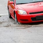 Car hitting pothole